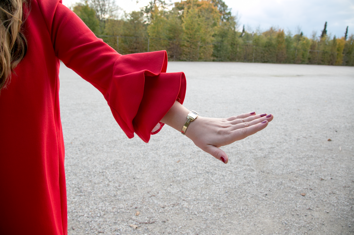 a bright red flute sleeve of a jacket
